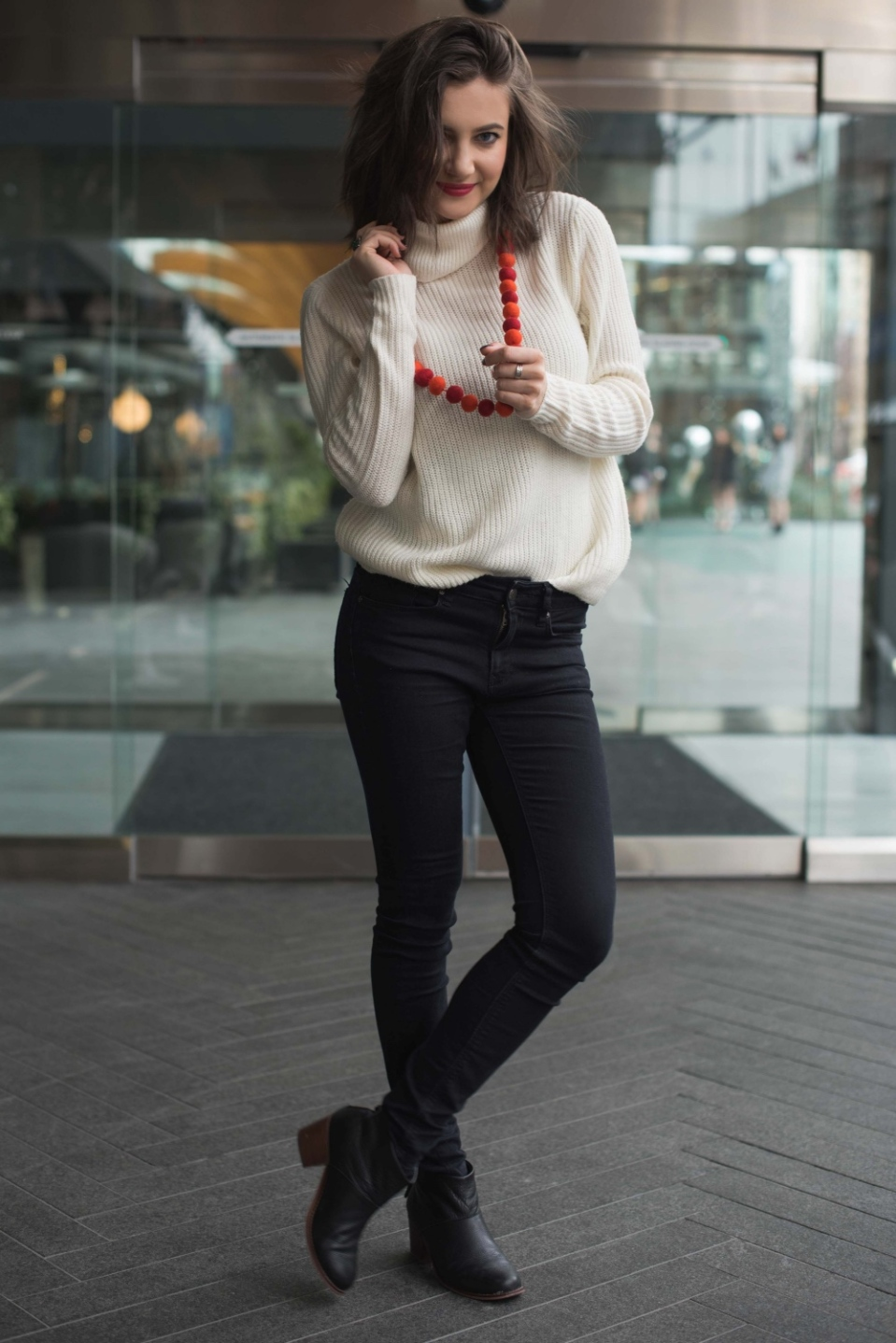 white-sweater-black-jeans